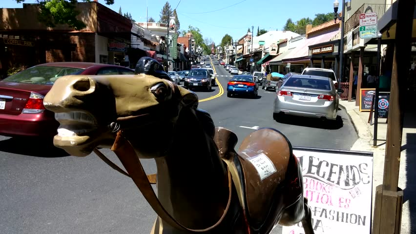 Sonora, California - April, 2015 - Downtown Washington Street with coin operated horse ride machine in the foreground.