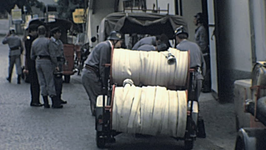 ITALY - 1977: firefighters preparing hydrants in 1977 in Italy - HD stock footage clip