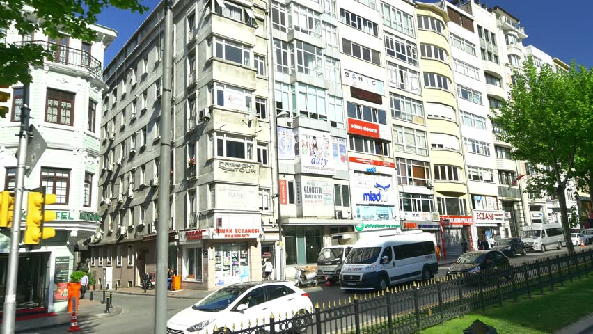 ISTANBUL - MAY 4, 2015: Harbiye Cumhuriyet Street, a street of massive blocks of flats for residents and various travel agencies