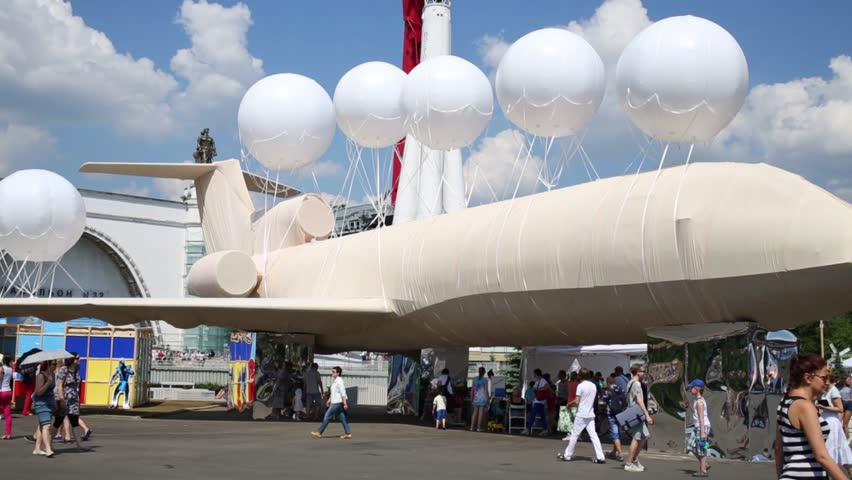 MOSCOW, RUSSIA - MAY 24, 2014: Exhibits rocket and the plane decorated with balloons at the Festival Polytech in the city park of All-Russian Exhibition Center in Moscow. - HD stock video clip