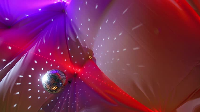Party light of a disco ball projected on a ceiling - HD stock footage clip