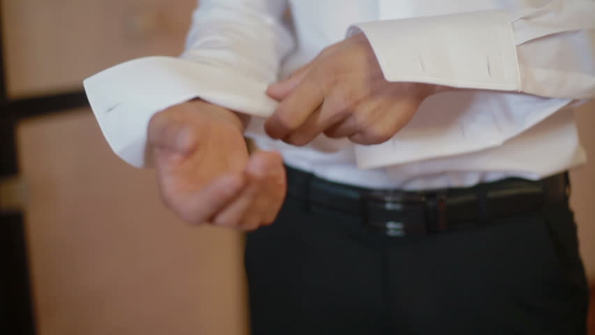 Close up of a man's (groom's) hand while fastening cuff HD - HD stock footage clip