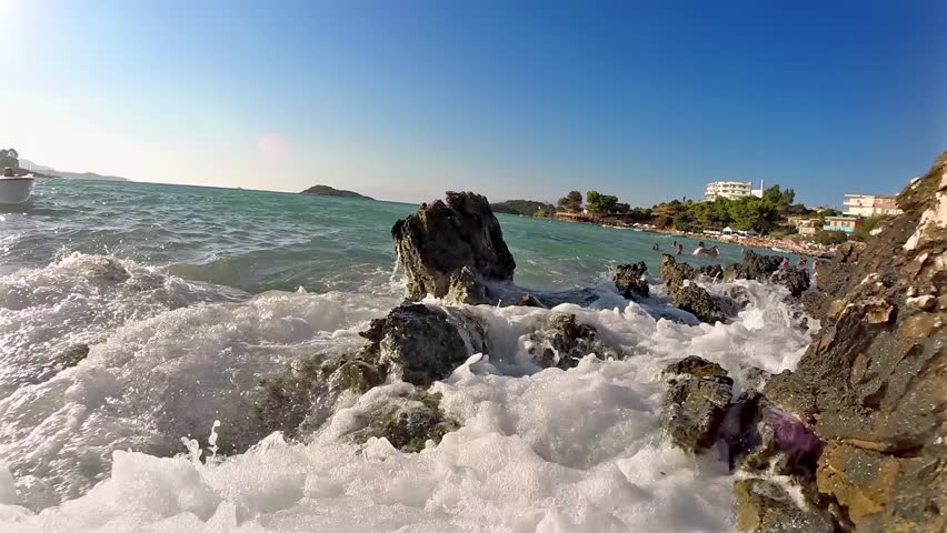 Gentle sea waves touching rocks of Grand Cayman