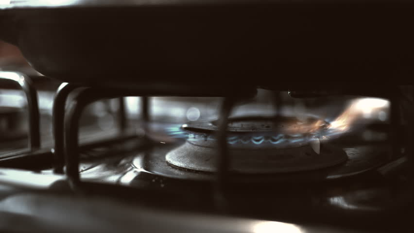 Heating up the frying pan on the stove. Shot with high speed camera, phantom flex 4K. Slow Motion. Unedited version is included at the end of clip.