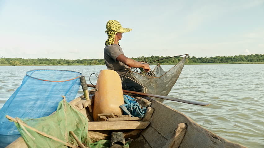 Fisherman rowing  boat for catching shrimp , southeast asia, Cambodia.