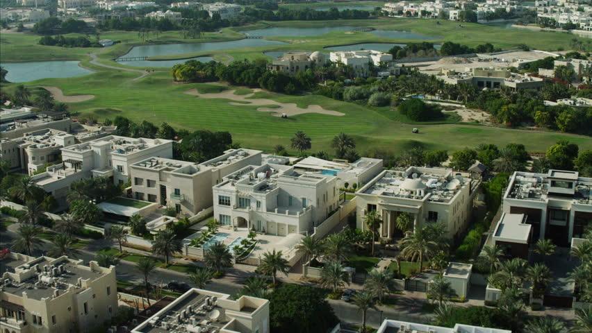 Aerial dubai luxury homes emirates hills golf persian gulf for Dubai luxury homes photos