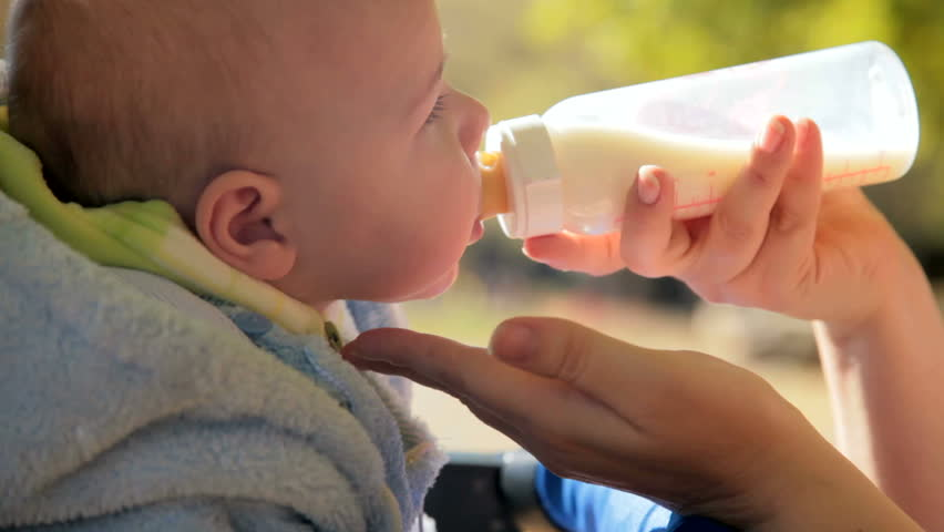 mother's hand feeding baby - HD stock video clip