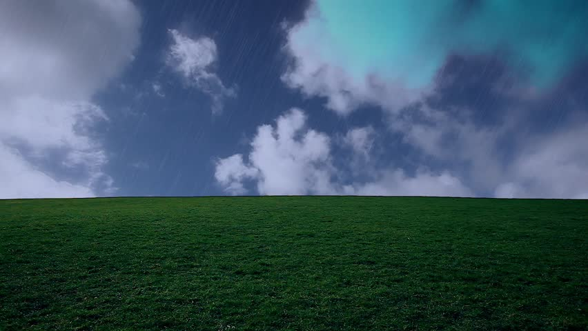 man walking on the edge of a green hill with beautiful clouds above rainy day  - HD stock video clip