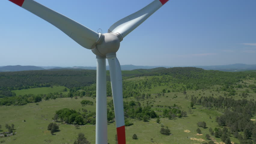 Aerial - Close-up of wind turbine propeller - 4K stock footage clip