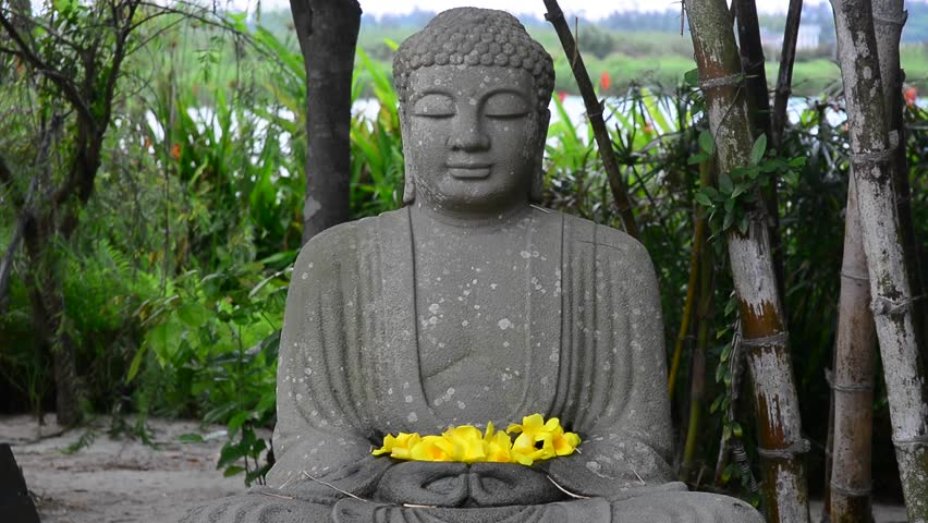 Statue of stone Buddha in the garden  - HD stock footage clip