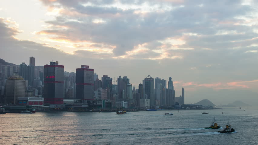 HONG KONG - CIRCA 2013: Time Lapse of Cloudy Sky at Sunset Times at Victoria Harbour in Hong Kong