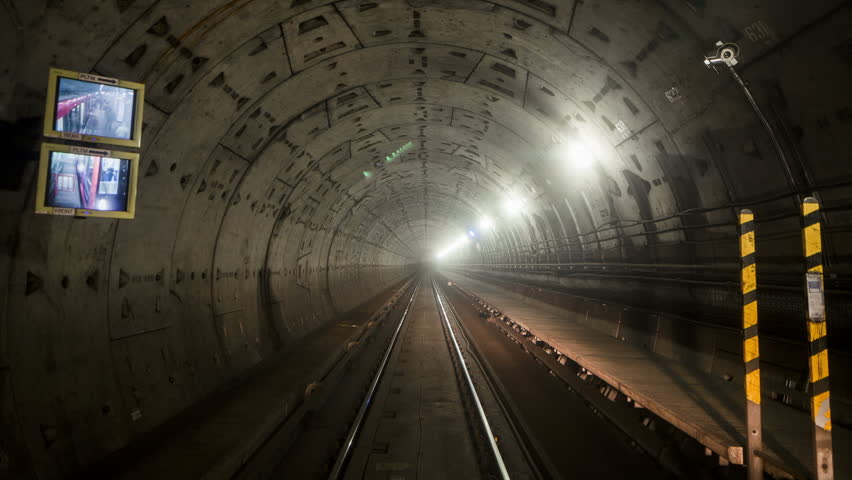 A seamlessly looping HD timelapse clip showing the view from the front of an underground train as it hurtles through tunnels and stations.  - HD stock video clip