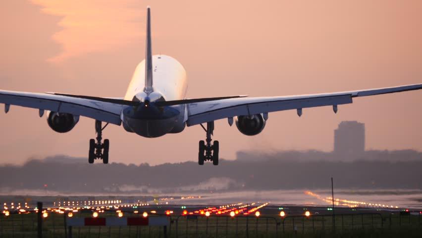 4K Airplane landing at dusk