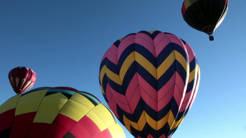 PANGUITCH, UTAH - JULY 2014: Hot air ballooners come from all over to Panguitch, Utah as it hosts the annual hot air balloon festival. Four colorful balloons grace the clear blue morning sky