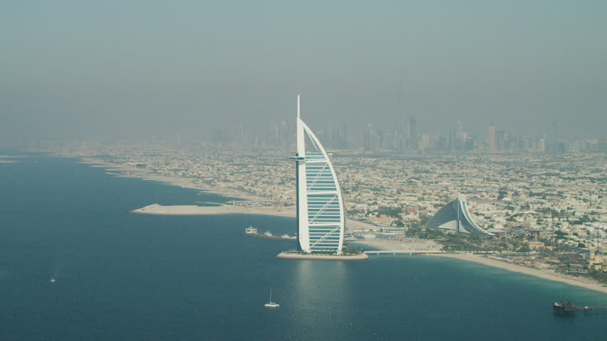 Yacht sailing with tropical island on background travel for Sailboat hotel dubai