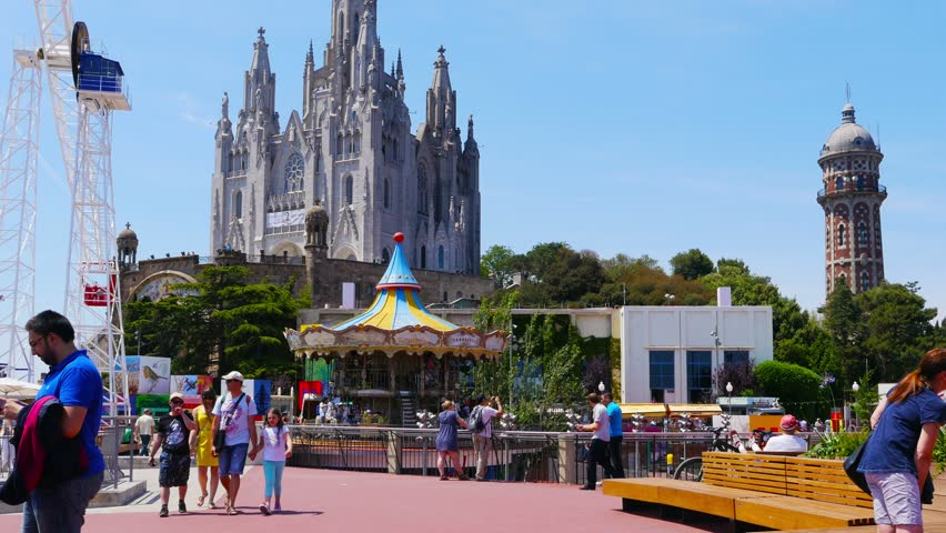 BARCELONA, SPAIN, CIRCA MAY 2015: people with their children visiting attraction park on Tibidabo mountain. - 4K stock footage clip