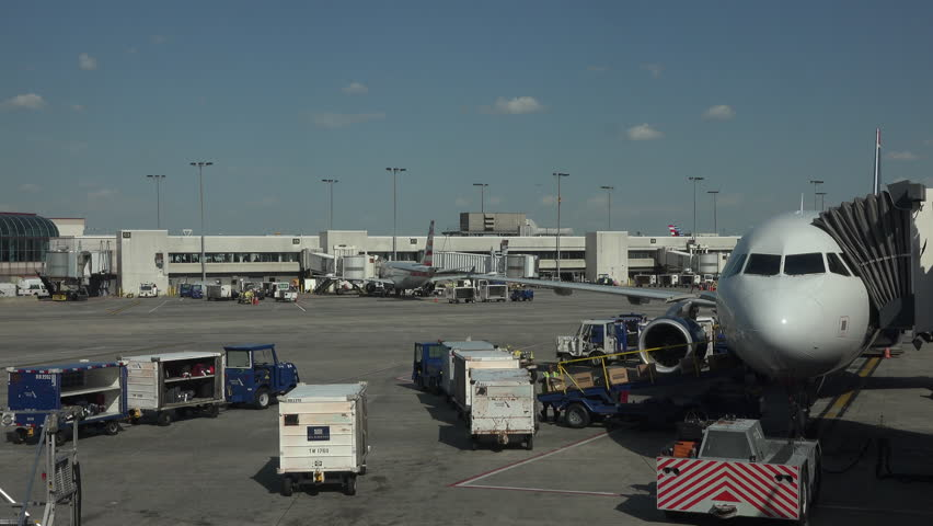 WASHINGTON, DC - APR 2015: Aircraft emtpy cargo Dulles International Airport ramp 4K. Dulles International served 21.6 million passengers in 2014.  A major terminal for business and vacation travel. - 4K stock video clip