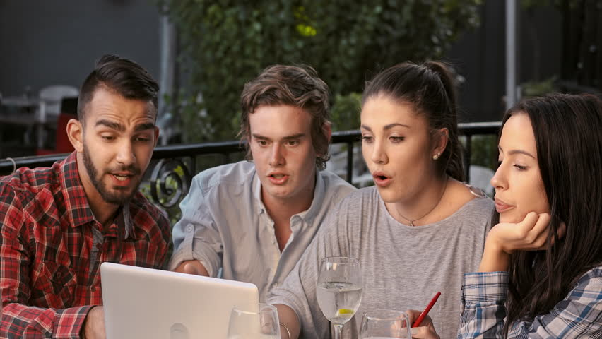 4k medium shot of multicultural group of university students resourcing information via cloud/ information database technology using a digital laptop computer and wifi at their local study hang out.  | Shutterstock HD Video #10527488