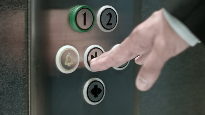 Man pushes a button opening elevator doors close up stock for Man door design