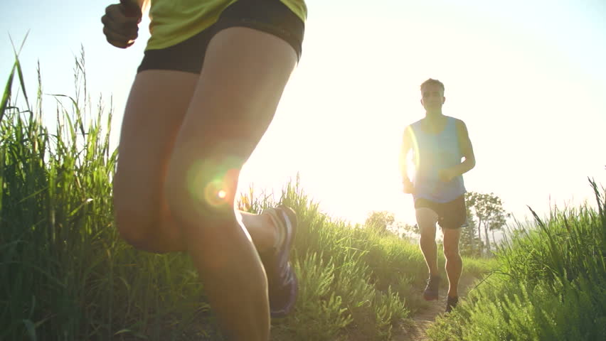 Slow Motion Couple Running At Grassy Park During Sunset