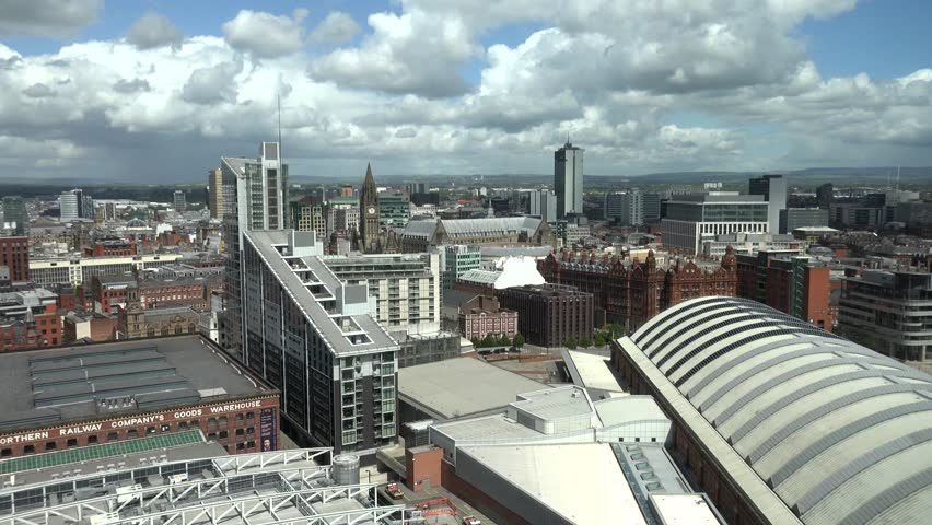 MANCHESTER - ENGLAND, MAY 28, 2015, ULTRA HD 4K Timelapse of cloud pass over Manchester city with tourism attraction by day