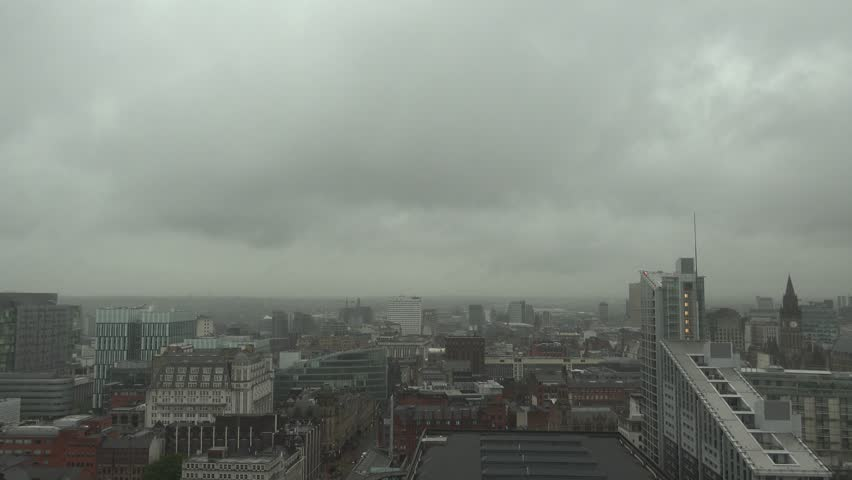 ULTRA HD 4K Aerial view of rainy day and Manchester skyline, storm cloud over city
