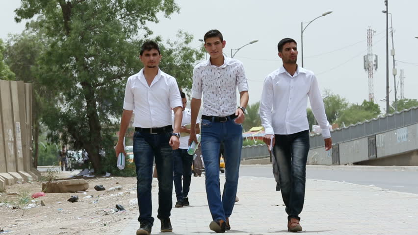 BAGHDAD, IRAQ - MAY 2015: University students get out of their university at Palestine road in Baghdad, Iraq, low angle