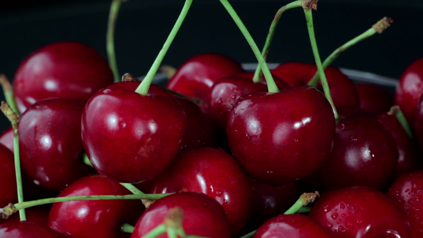 A Group of of Ripe Red Cherries Taken from a Beautiful Dish. Close up