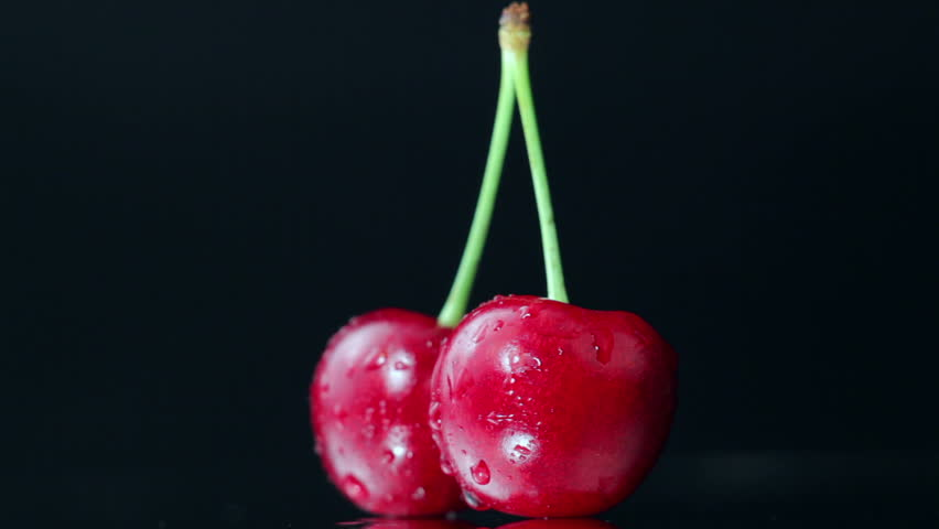 Two Ripe Beautiful Red Cherries Rotate on The Table