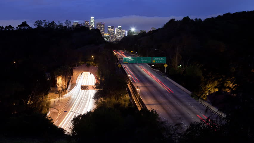 Time lapse of long exposure traffic car lights on the 110 Freeway and the Los Angeles California city skyline at night. | Shutterstock HD Video #10539782