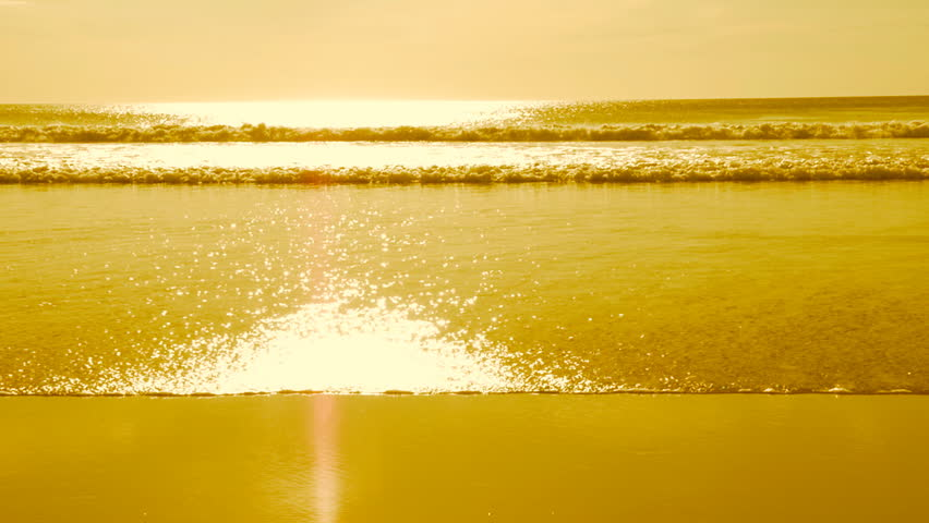 Slow motion ocean in gold. Surf and beautiful crashing wave. Pacific Ocean in Costa Rica. Slow motion. Surf coming in with crashing sunlit wave. Gold tint applied in post.