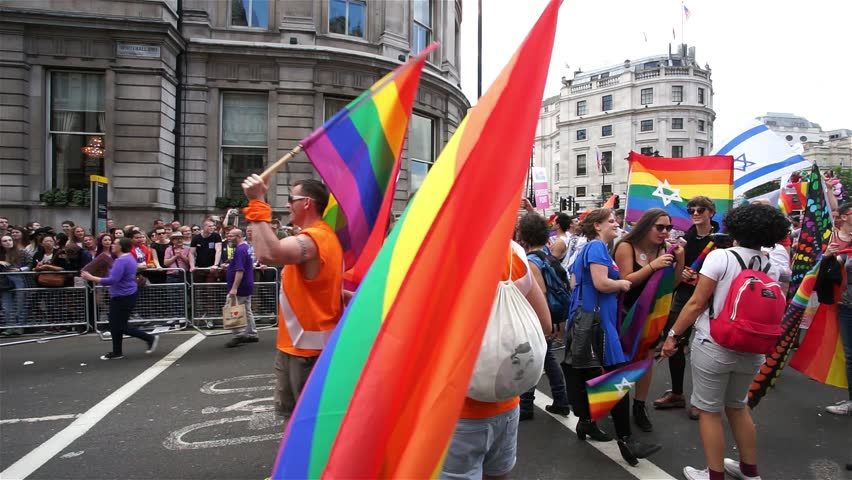 LONDON - JUNE 27: People take part in London's Gay Pride, 2015 Worldpride on June 27, 2015 in London, UK, estimated 25,000 people took part in the march, Parade to support gay rights.  - HD stock footage clip