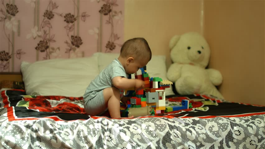 Adorable small boy playing with toys,  - 4K stock footage clip
