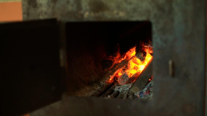 Man heating stove at sauna. - HD stock footage clip