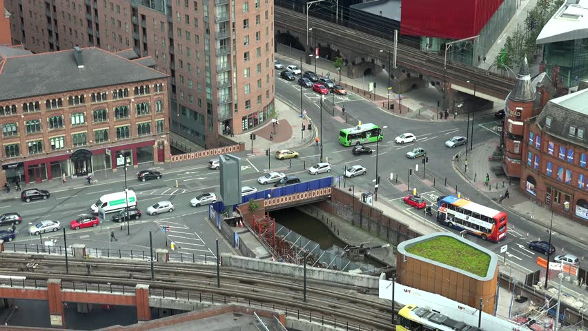 MANCHESTER - ENGLAND, MAY 28, 2015, ULTRA HD 4K Timelapse of urban commuter transportation at rush hour by day