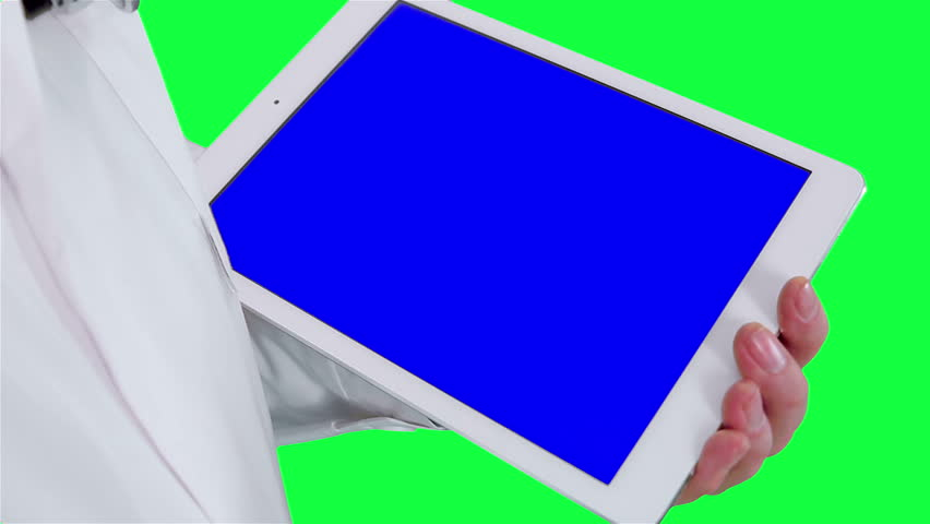 doctor uses a tablet computer closeup. Chroma key background. Tablet in the hands of a medic in a white coat