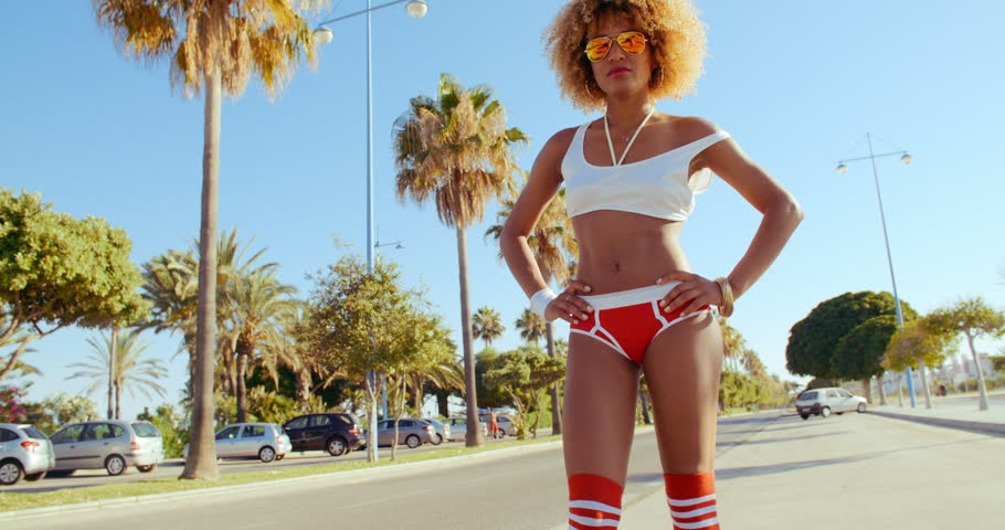 Exotic Retro Stylized Girl Posing With Palm Trees on the Background. Slow Motion Video Recorded at 120fps - 4K stock video clip