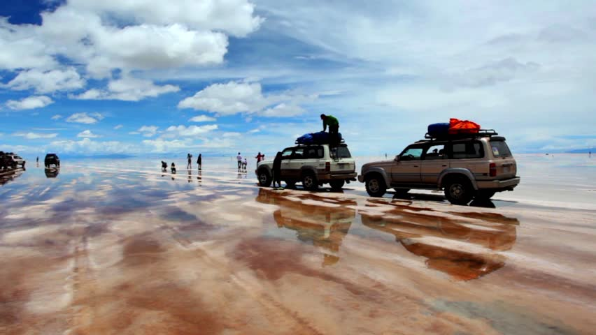 Bolivia salt flats on a sunny day with clouds. - HD stock video clip