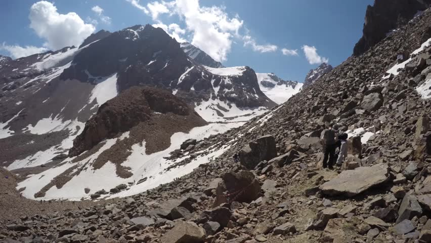 Long line of tourists in the Mountains - HD stock footage clip