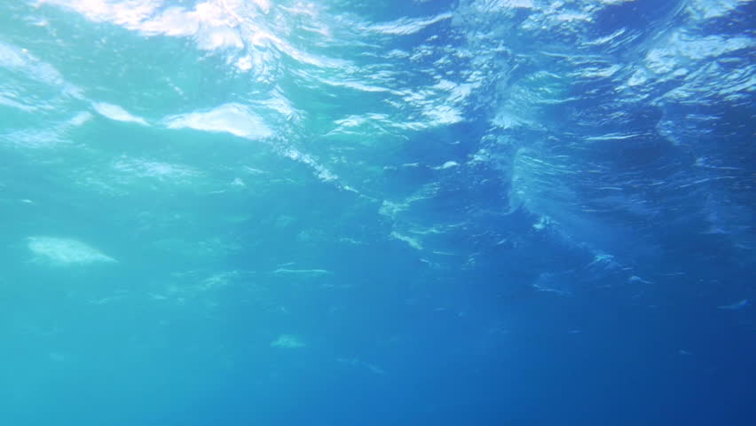 Slow motion shot of lumpy sea surface made underwater in sunny day. | Shutterstock HD Video #10680092