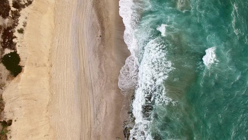 Aerial: Top shot sea moving down. Ocean 4K. coastline.