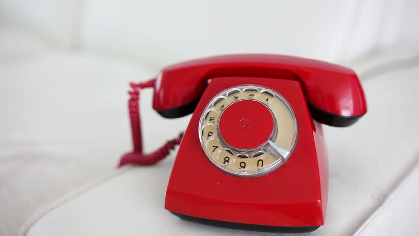 Young woman calling with a red retro phone at home, talking and laughing | Shutterstock HD Video #10694051