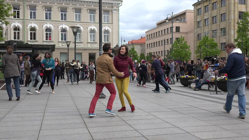 VILNIUS, LITHUANIA - MAY 16, 2015: people couple dance fun Lindy hop dance in square on May 16, 2015 in Vilnius, Lithuania. 4K UHD video clip. Annual music street day. Free event. Panorama shot. - 4K stock footage clip