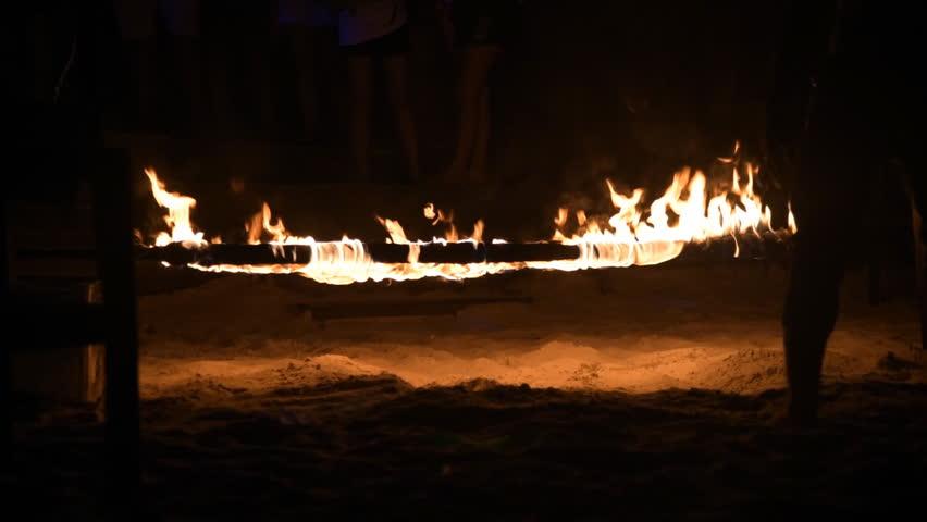 Dancing Fire Limbo at Beach in night | Shutterstock HD Video #10707668