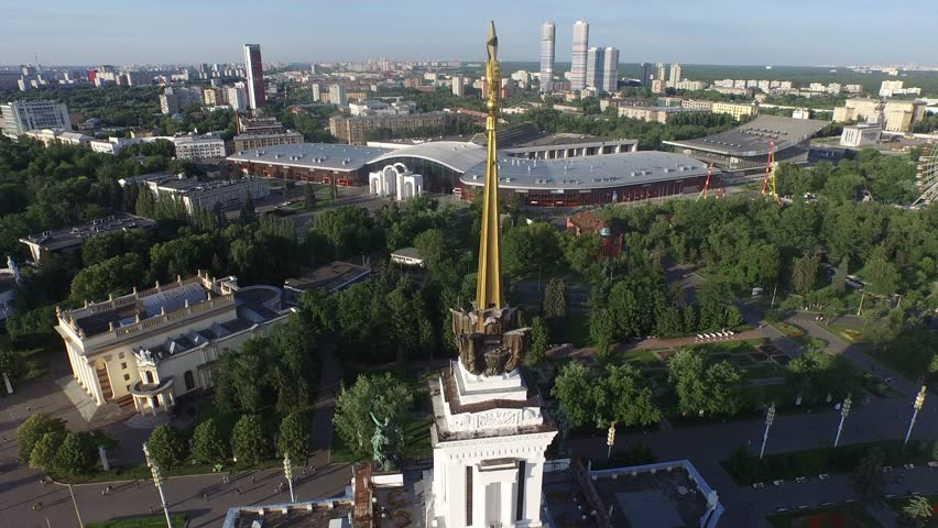 MOSCOW, RUSSIA - JULY 2015: Central Pavilion of VDHkH.  All-Russian Exhibition Center. HELICOPTER VIEW of Central Pavilion with surrounding park.  Part 2 (motion starts in part 1) - 4K stock video clip