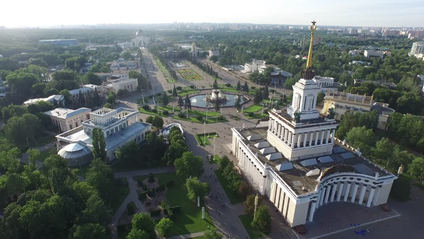 MOSCOW, RUSSIA - JULY 2015: Central Pavilion of VDHkH.  All-Russian Exhibition Center. HELICOPTER VIEW of Central Pavilion with surrounding park. - 4K stock footage clip