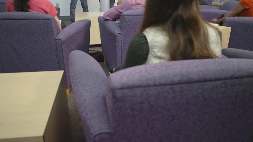 A student nervously gives a speech in class | Shutterstock HD Video #10724003
