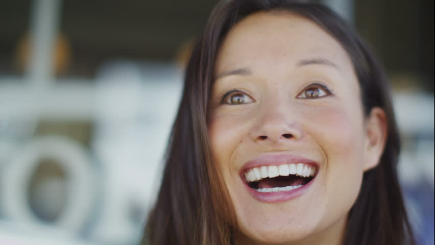 4K Attractive young woman talking cheerfully to someone off camera in a public setting in slow motion, shot on RED EPIC | Shutterstock HD Video #10725542