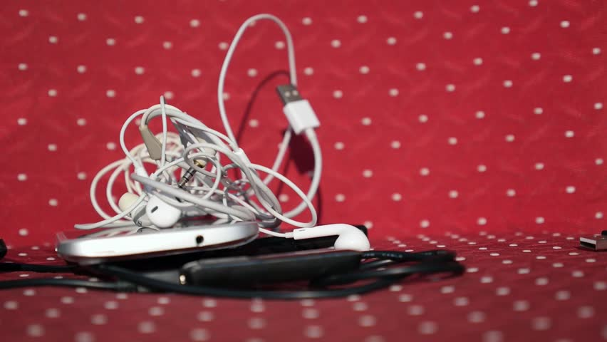 Falling Pile of Different Modern Devices: Tablet, Phones, Earphones, Charger, Cables, Players, Power Bank, Smartphones. Slow Motion. HD, 1920x1080.