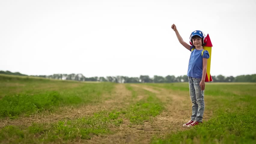 Happy kid playing in summer field | Shutterstock HD Video #10735910